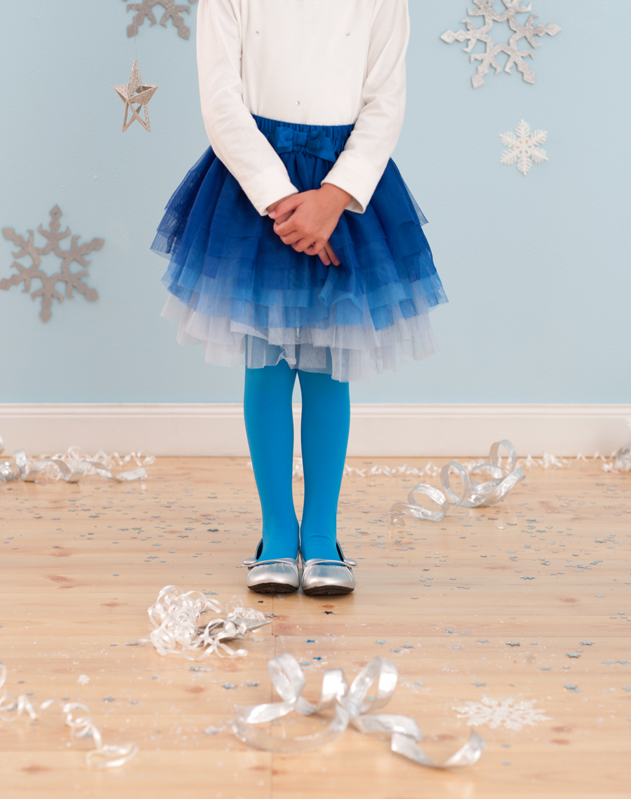 Parents magazine girl in party dress with snowflakes