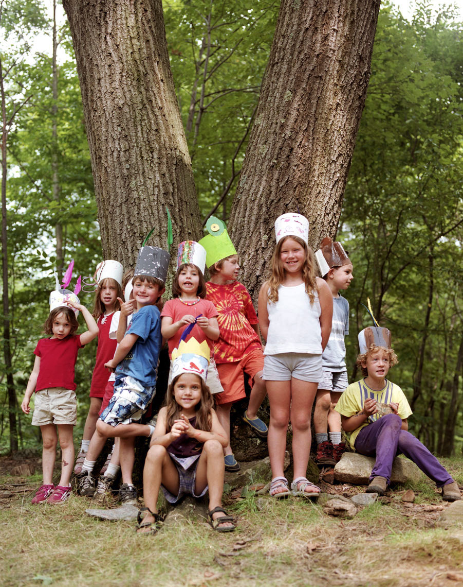 kids at summer camp family travel beneath a tree