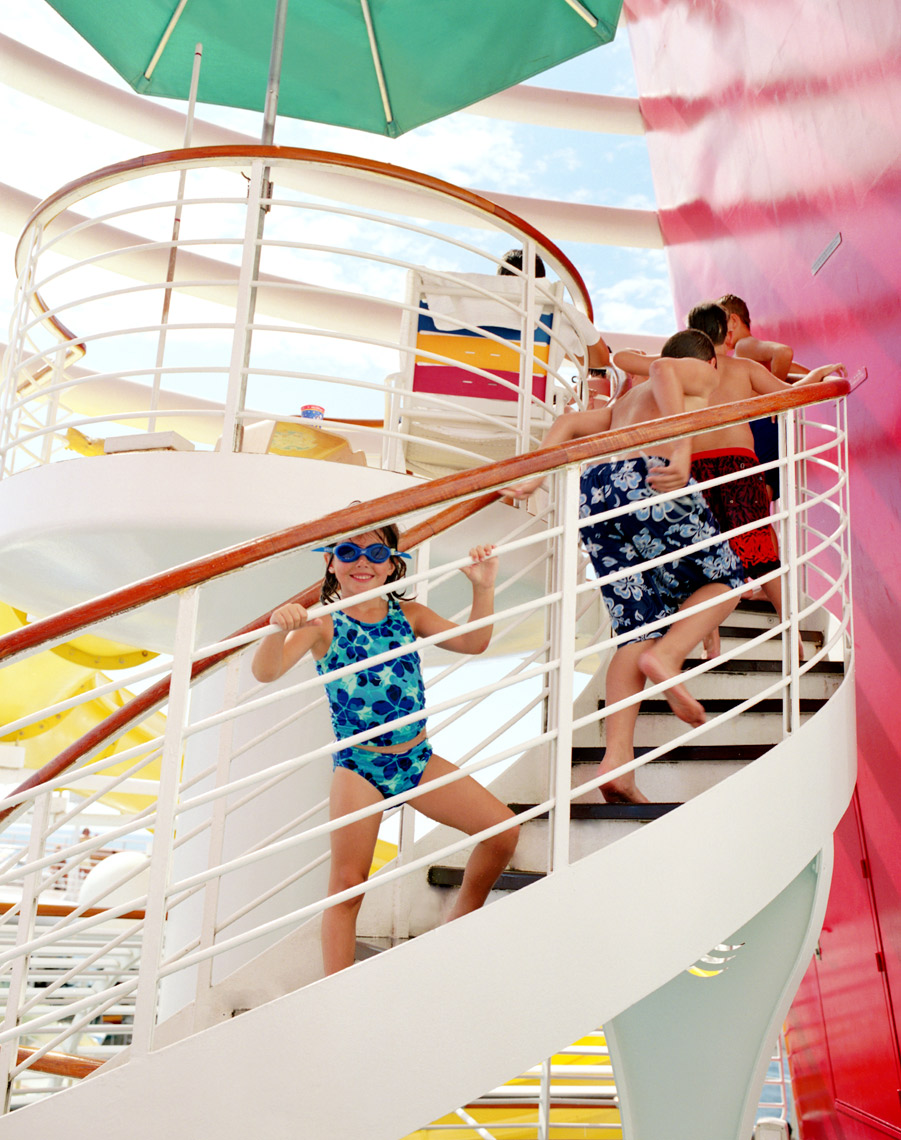 Disney cruise kids coming up stairs to water slide