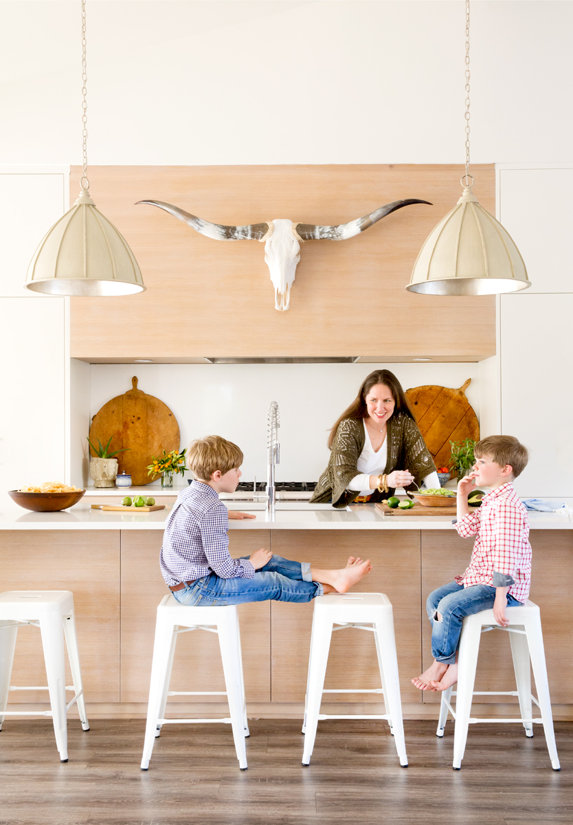 Mom with kids in modern kitchen Texas