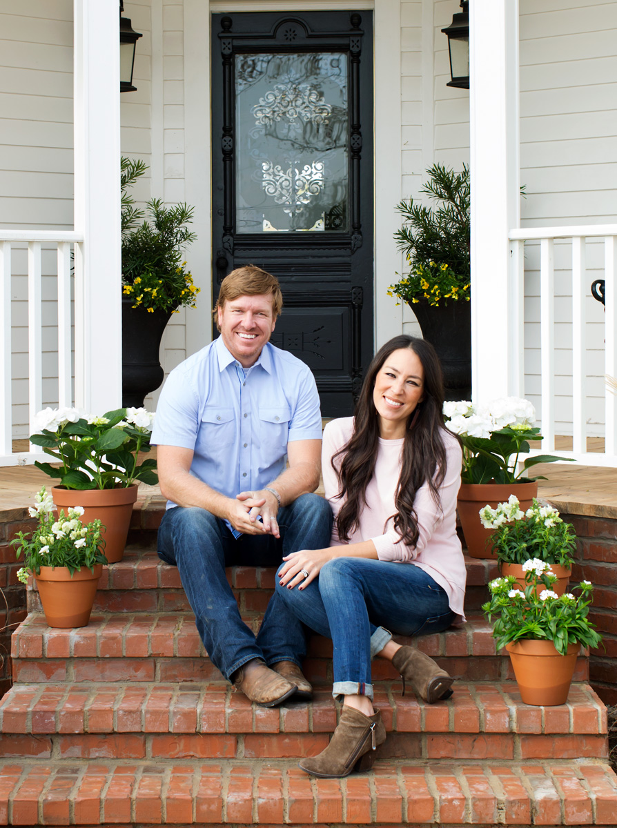 Chip and Joanna Gaines sit on the porch of their Magnolia House in Waco