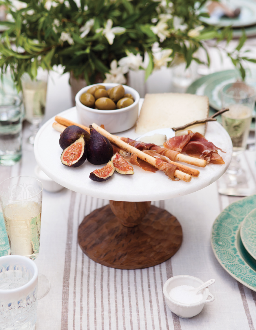 Camille Styles Entertaining spring tabletop cheese plate figs on Anthropologie plate breadsticks
