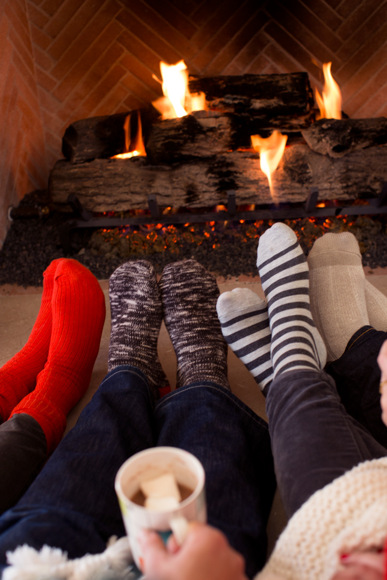 Camille Styles wool socks by the fire with Kate Spade mugs of hot chocolate