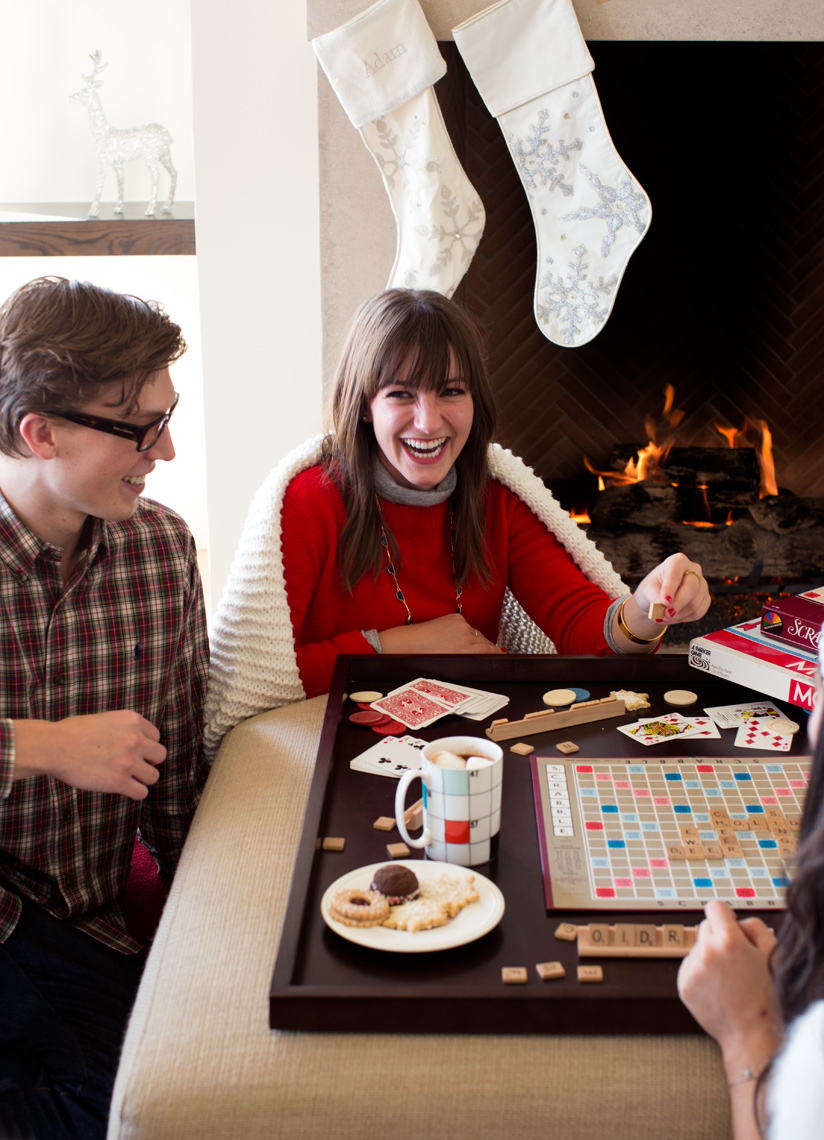 Camille Styles with Kate Spade holiday party playing scrabble by the fire