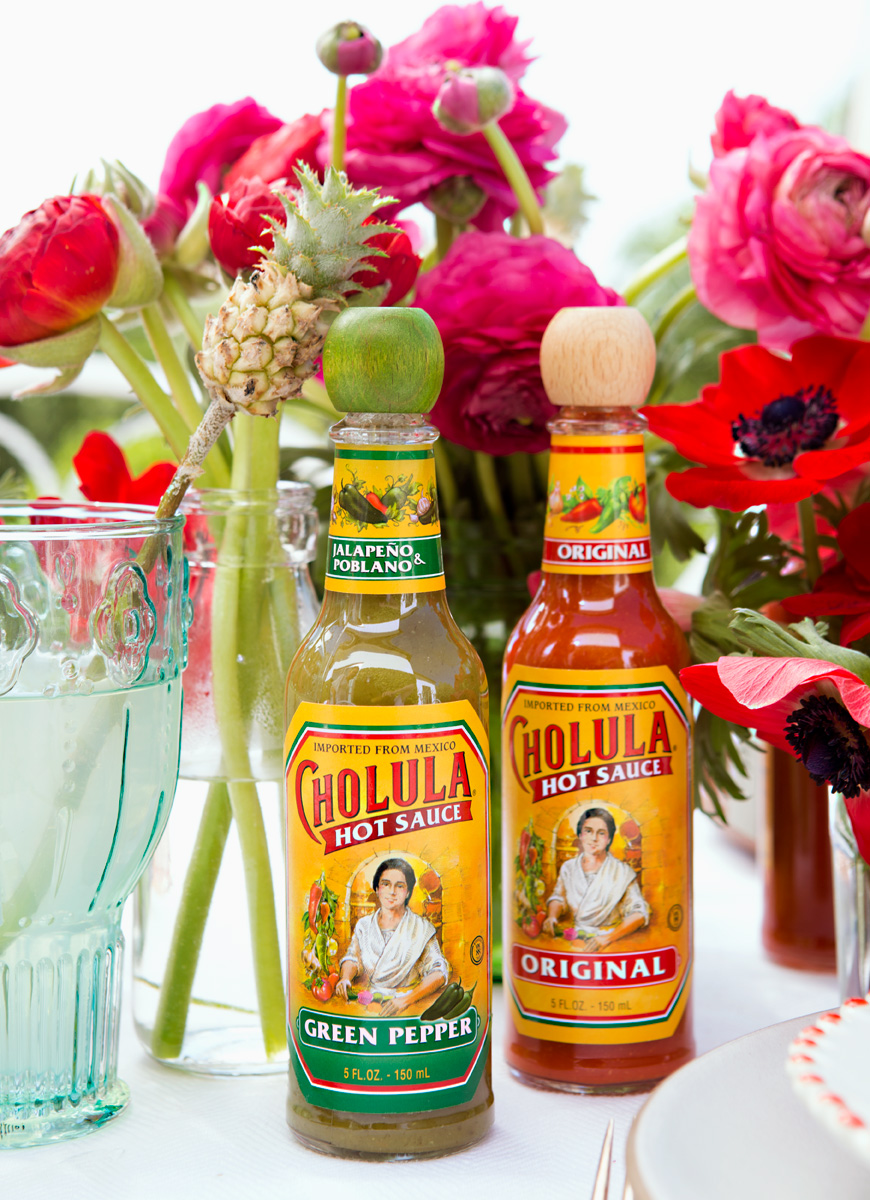 Camille Styles blog Cinco de Mayo Chalula hot sauce with flowers outside meals