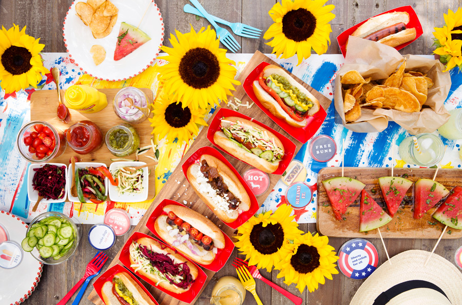 Camille Styles July 4th hot dog bar with fixings red white and blue theme