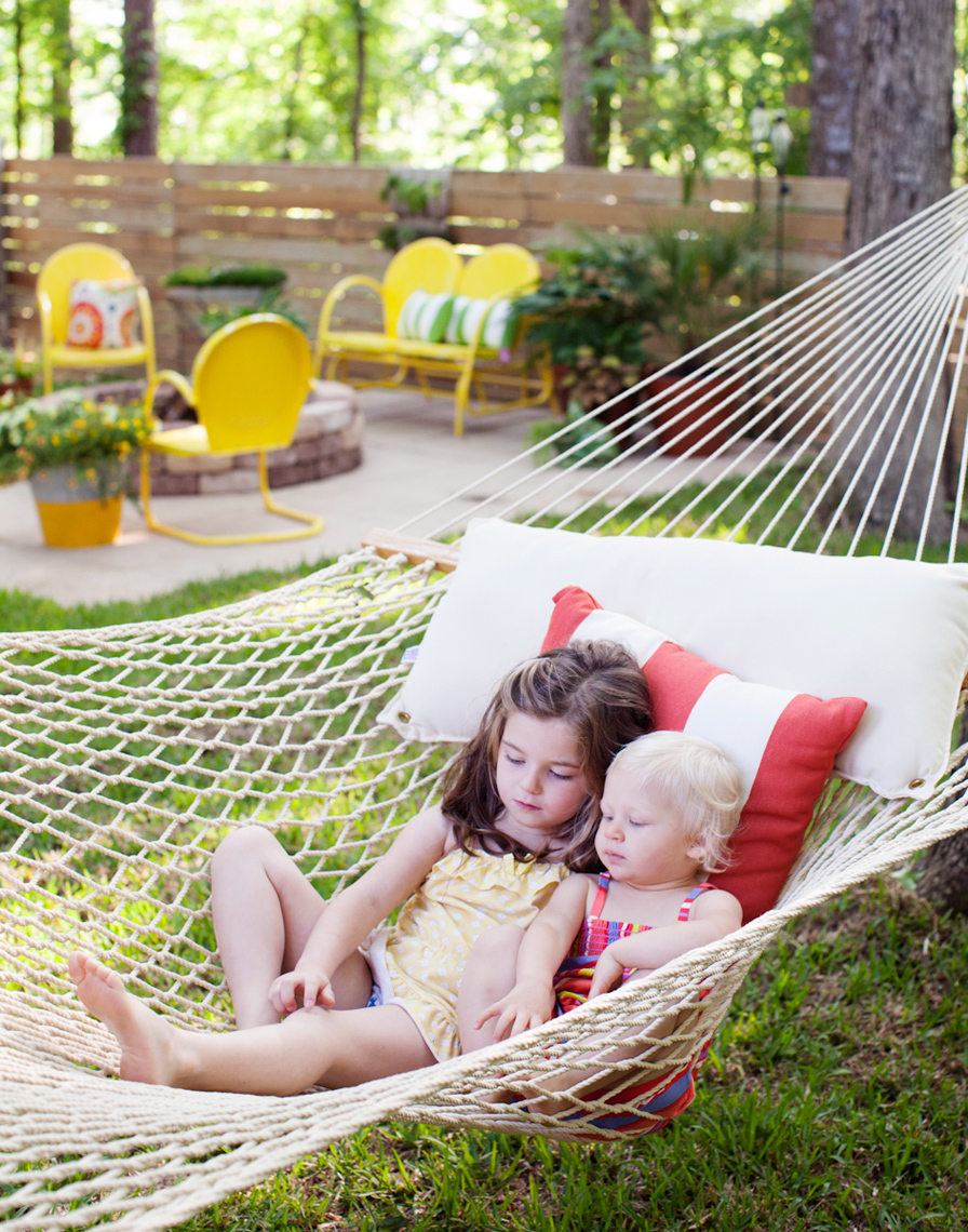 Good Housekeeping  magazine two girls on a hammock in the backyard