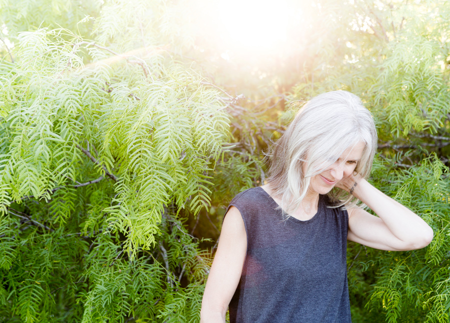 Grey hair woman enjoying the sunshine feeling free