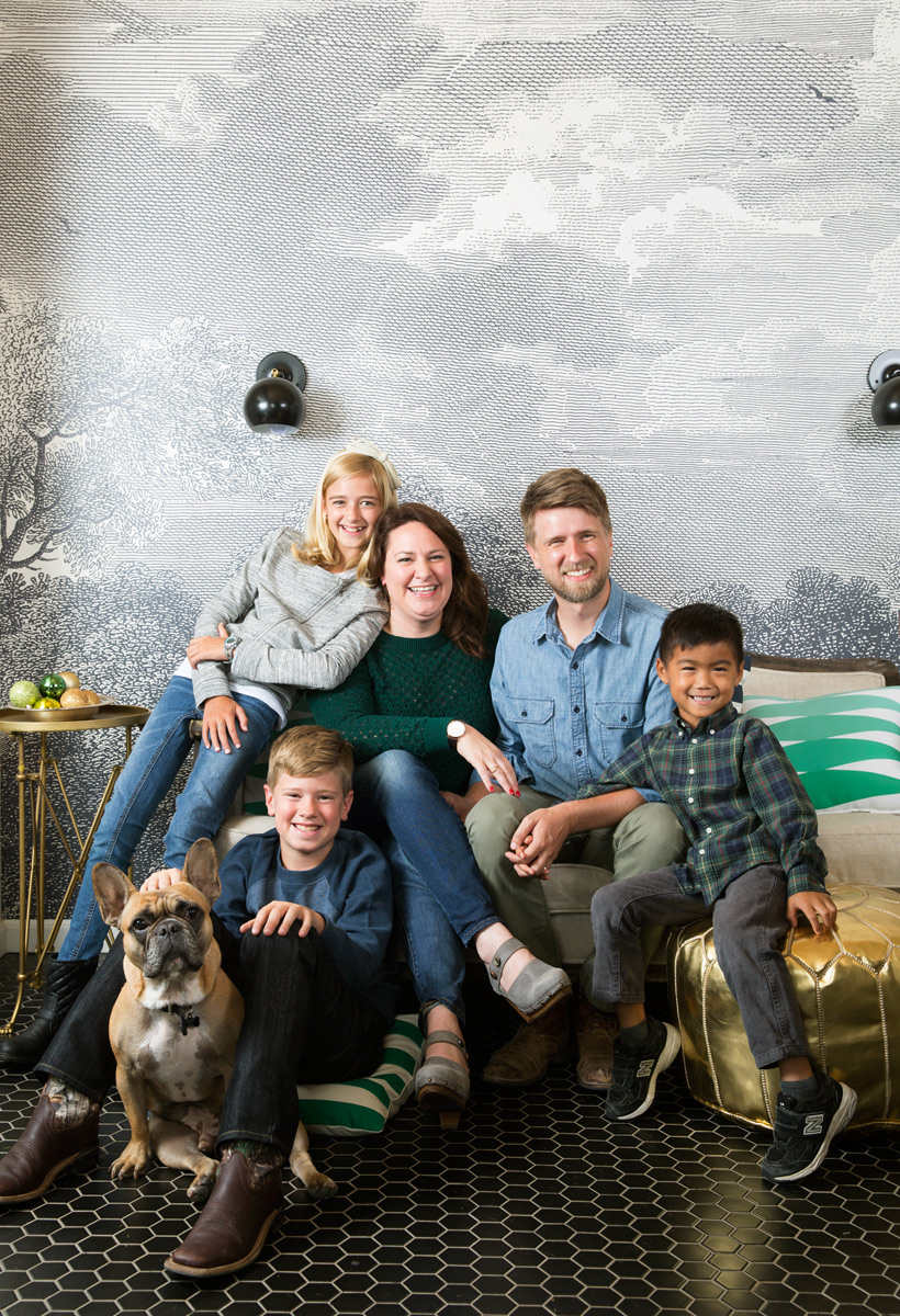Emily Paben family in their kitchen in Waco with mural behind them