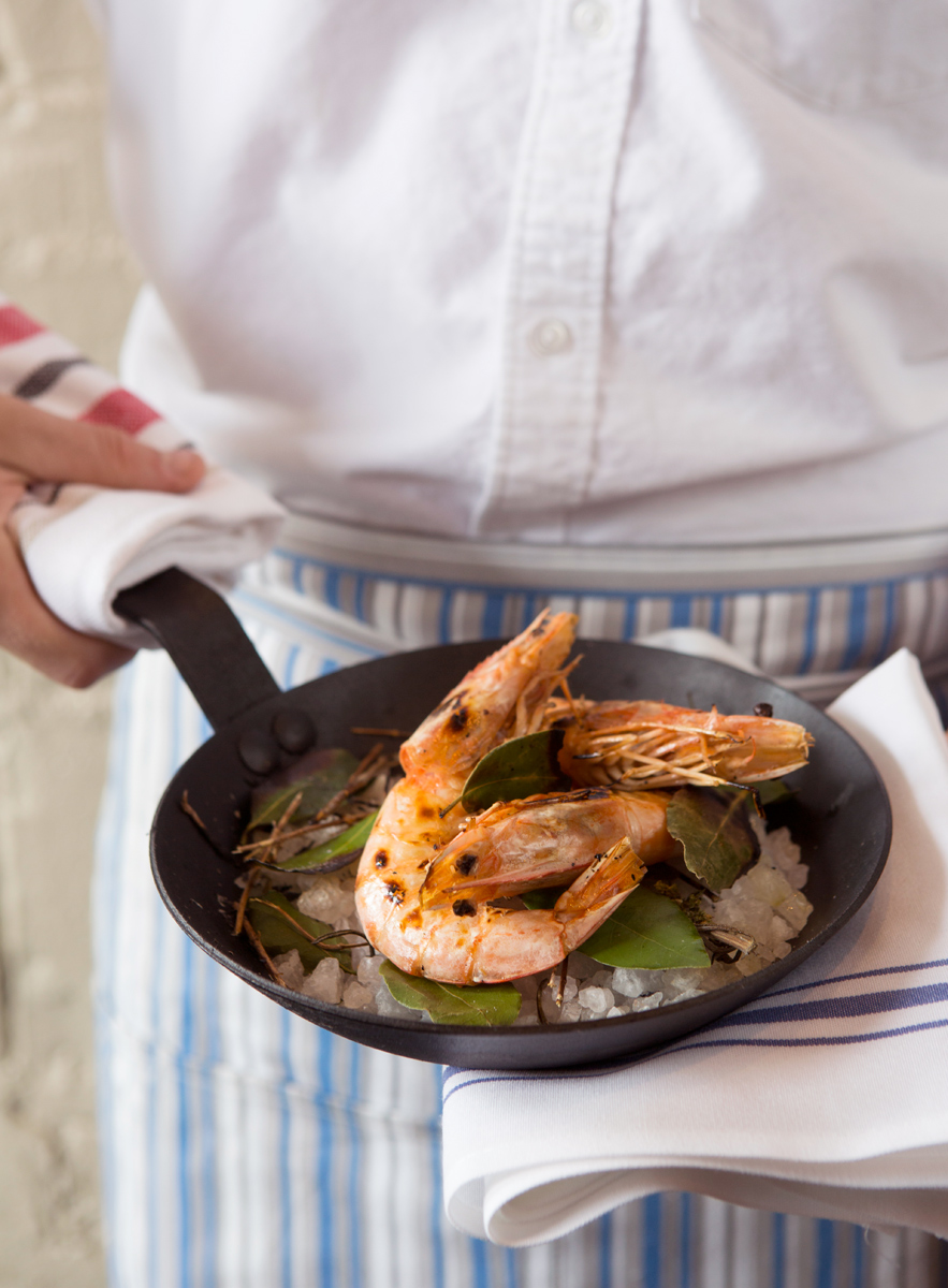 Houston restaurant Helen dish of shrimp on a skillet for Houstonia magazine