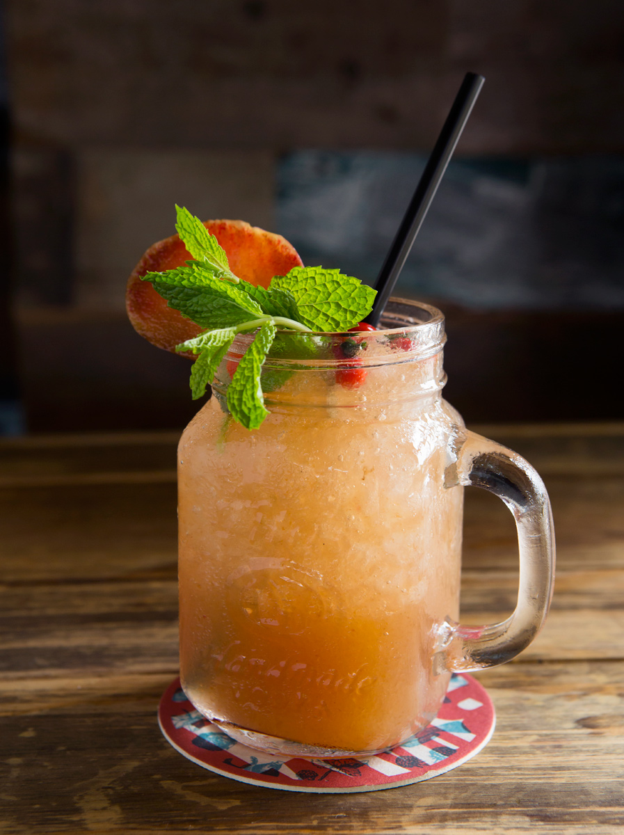 Austin food and beverage photographer Houston restaurants cocktail with mint