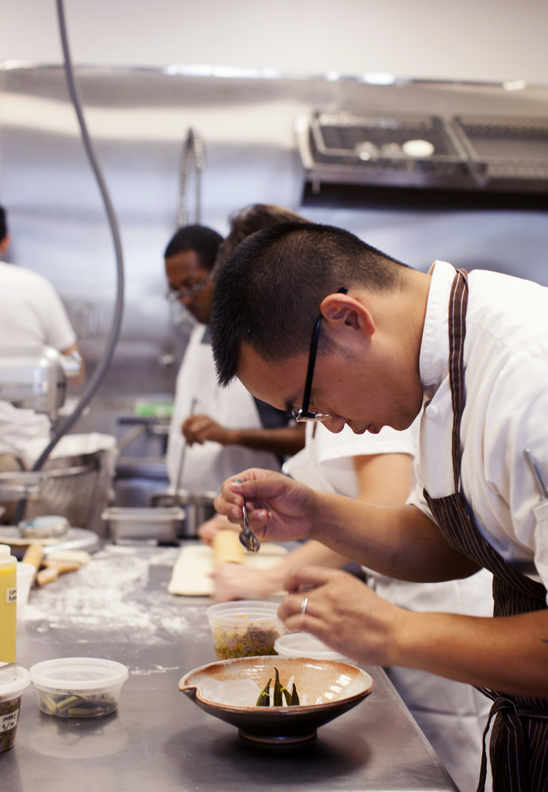 Chef Jason Wu for Houstonia magazine working in kitchen