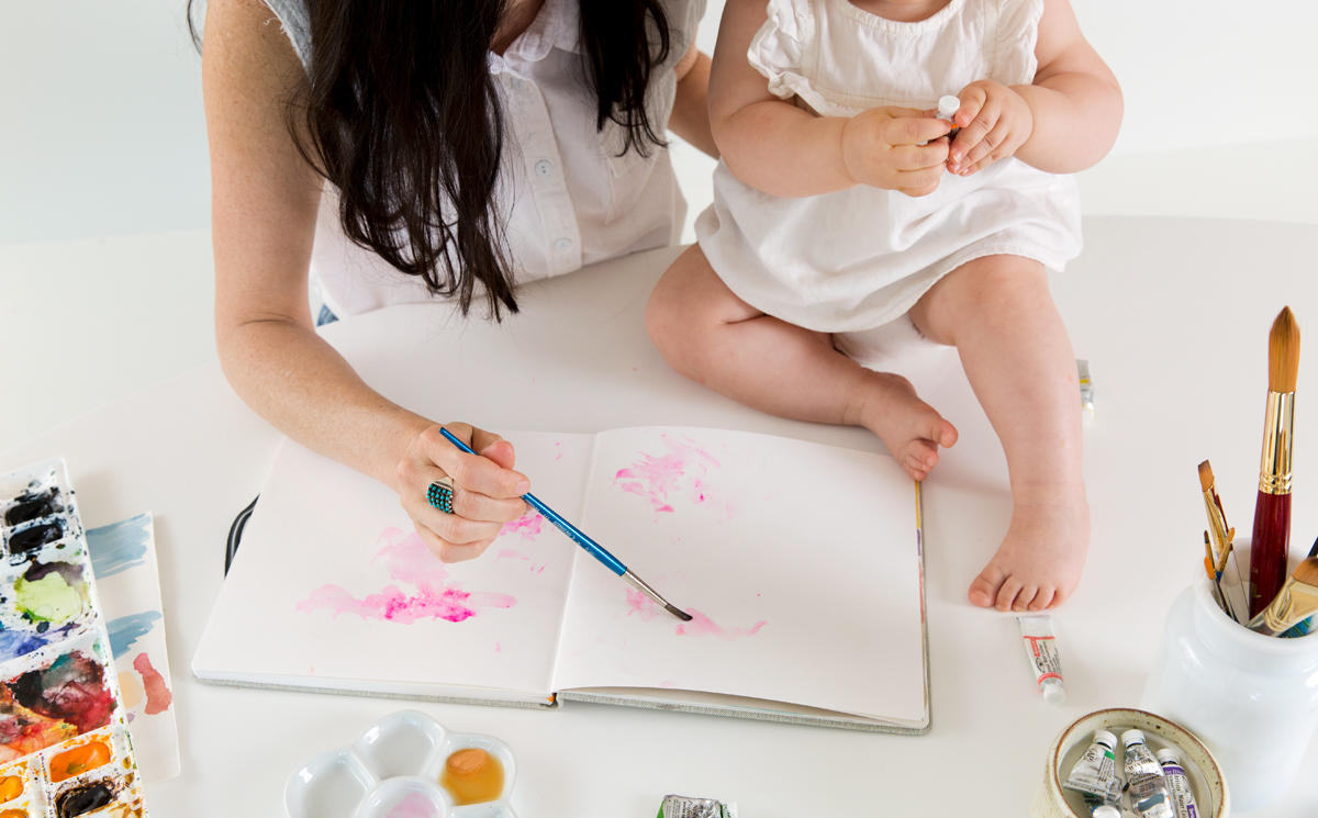 Artist Kelly Colchin and her daughter painting