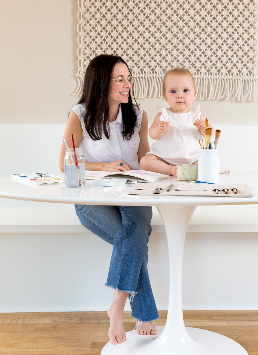 Artist Kelly Colchin and daughter painting together