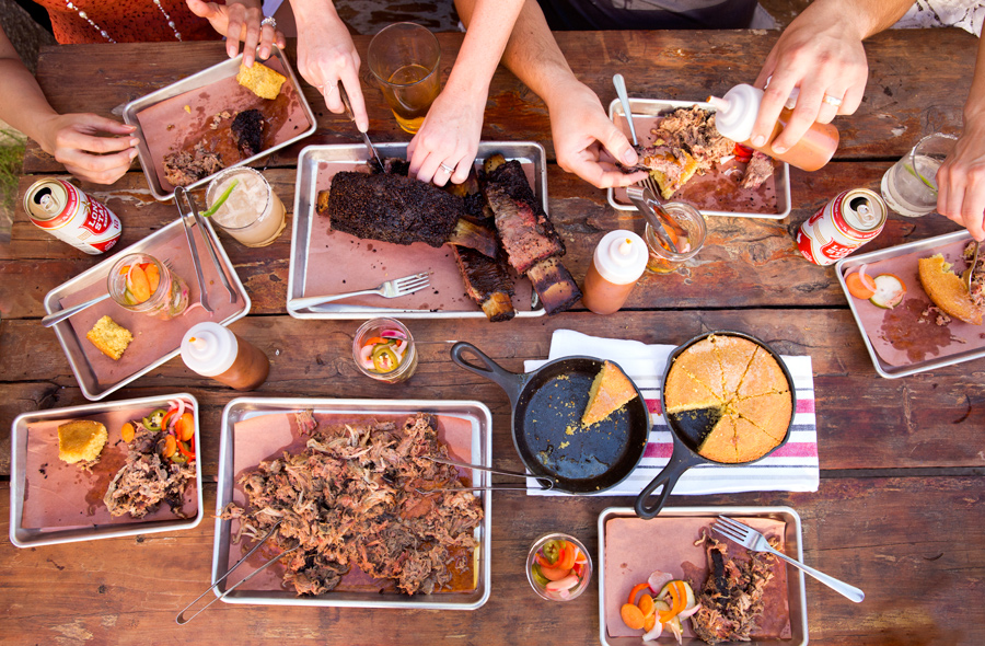 Texas Tailgate BBQ overhead on wooden table with beer and cornbread