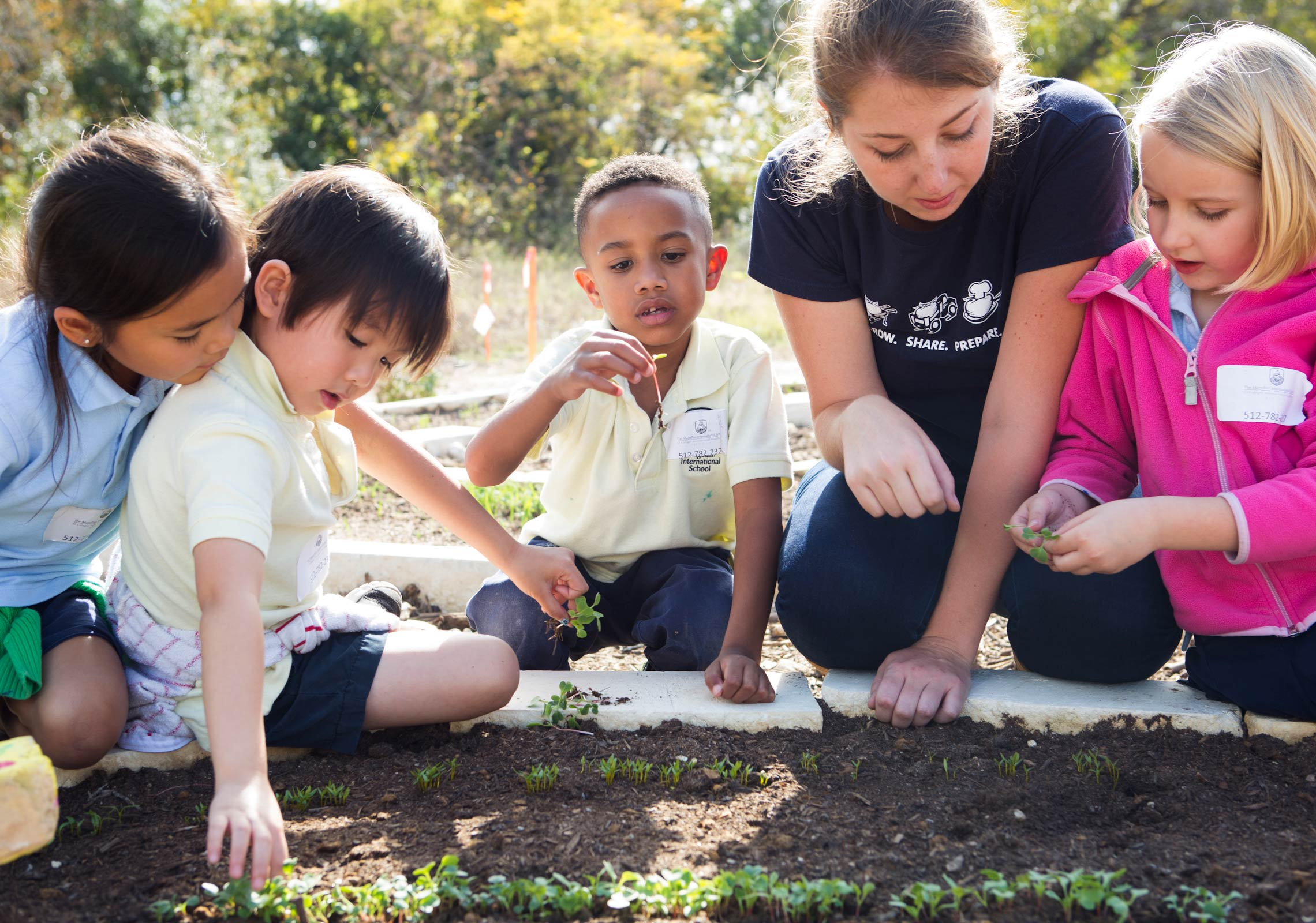 group of kids gardening class