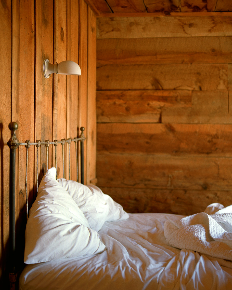 Rustic cabin with bed for travel magazine