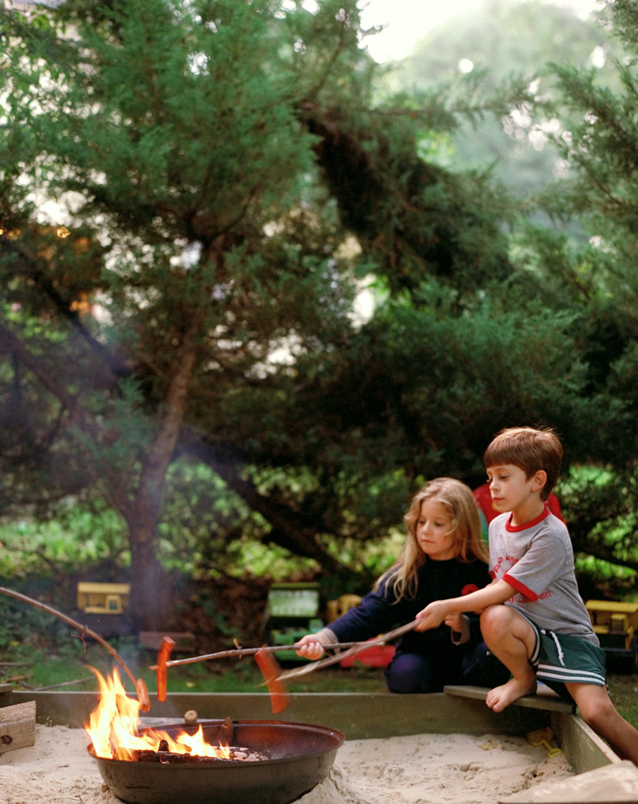 kids by campfire roasting marshmallows summer travel