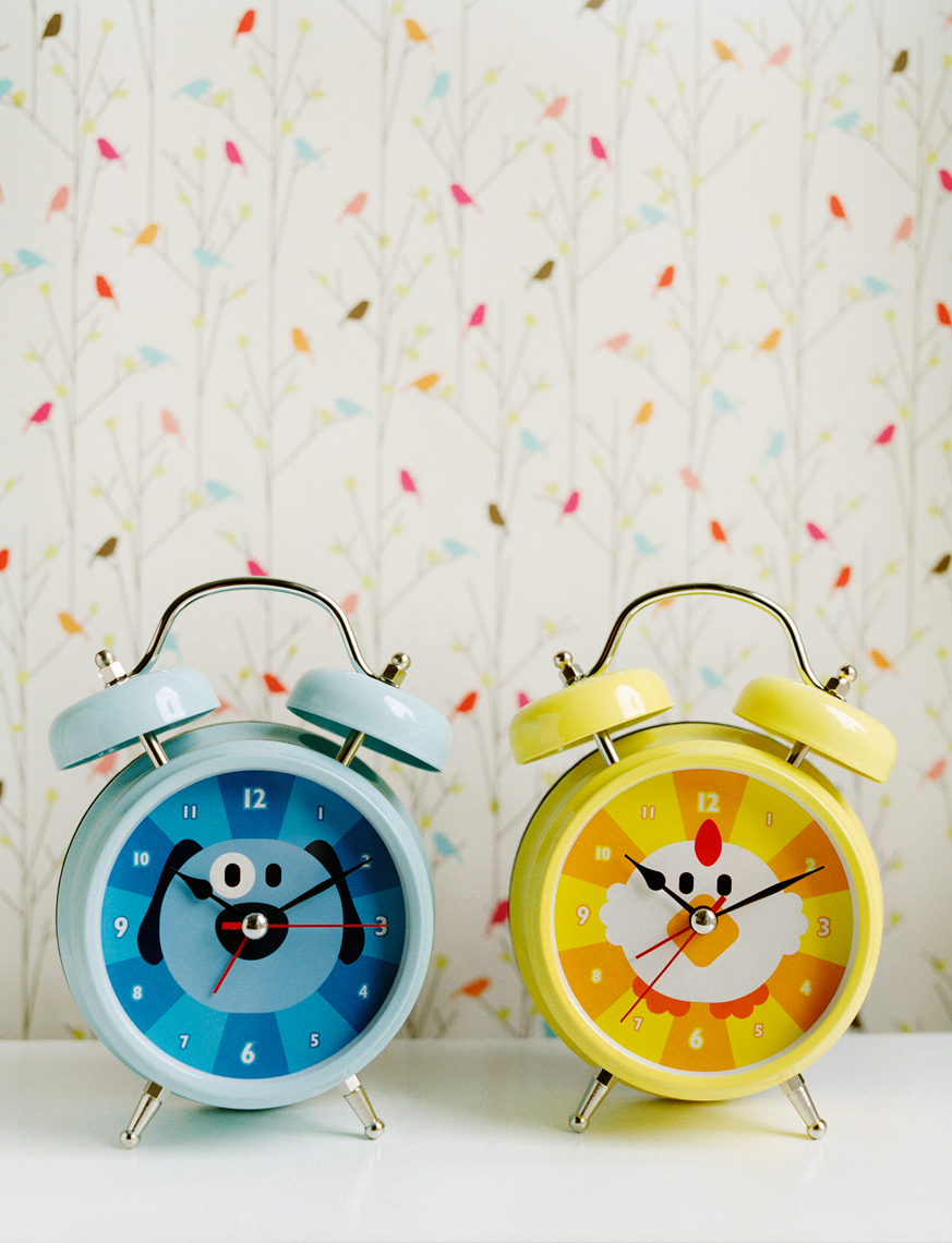 clocks on dresser with cute wallpaper