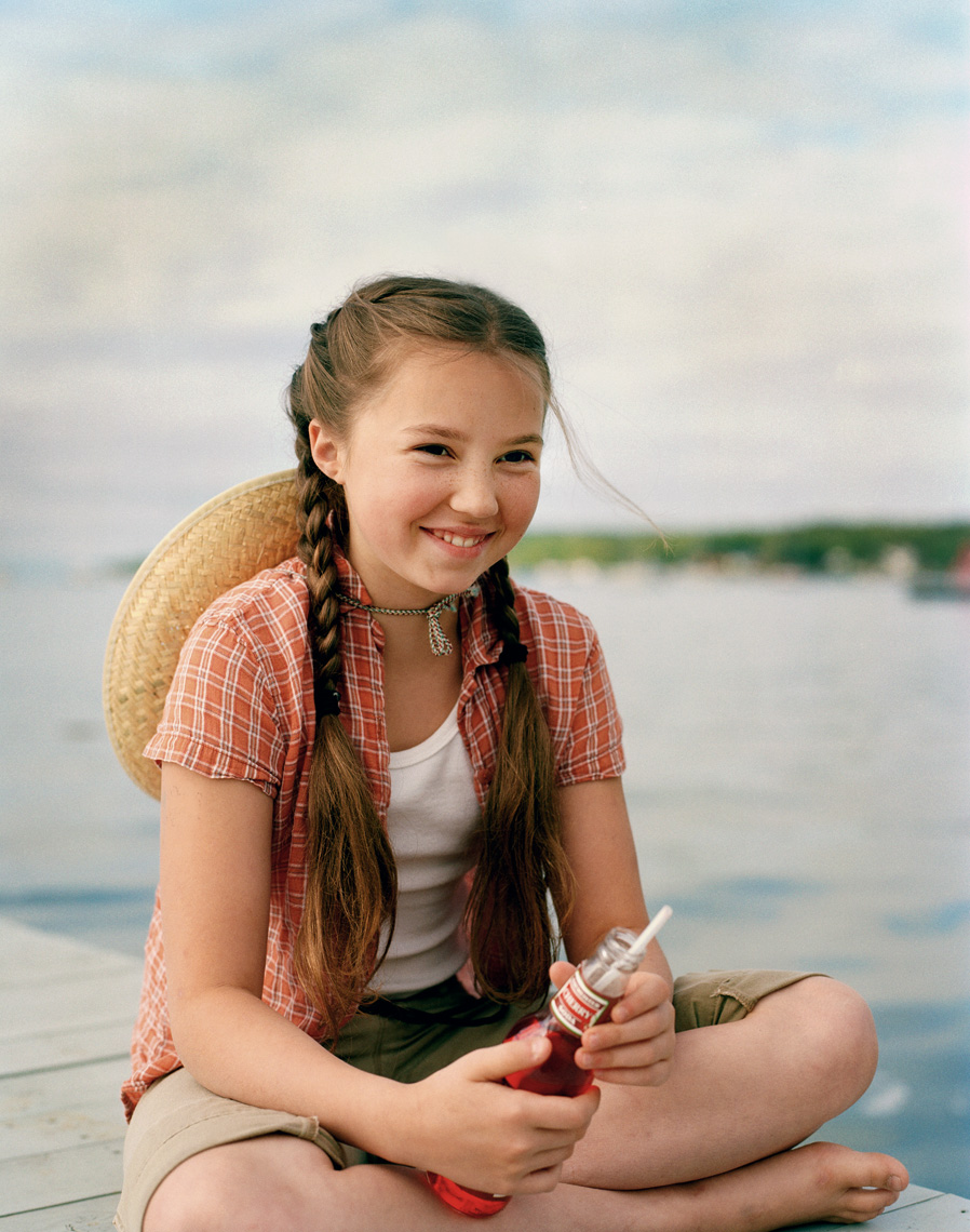 Door County girl on dock with soda for family travel magazine
