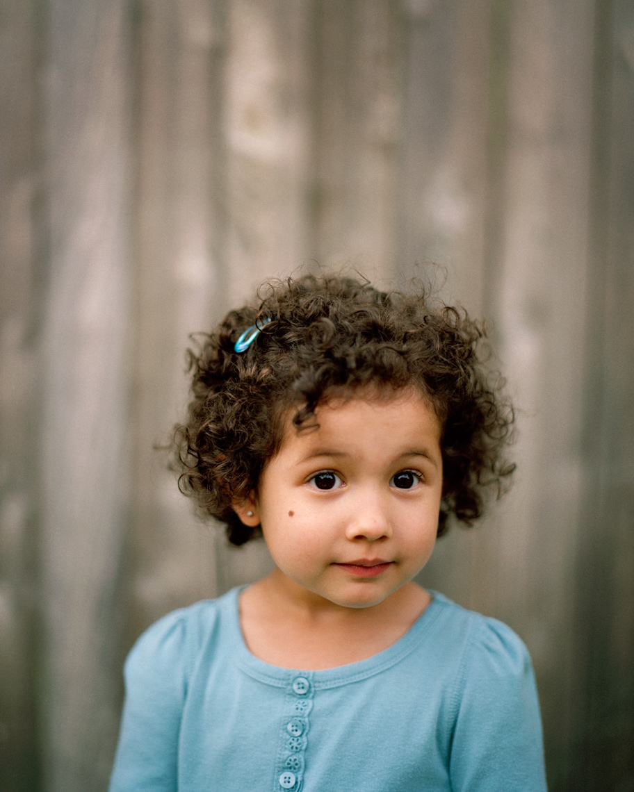 Small hispanic girl with smile in blue shirt