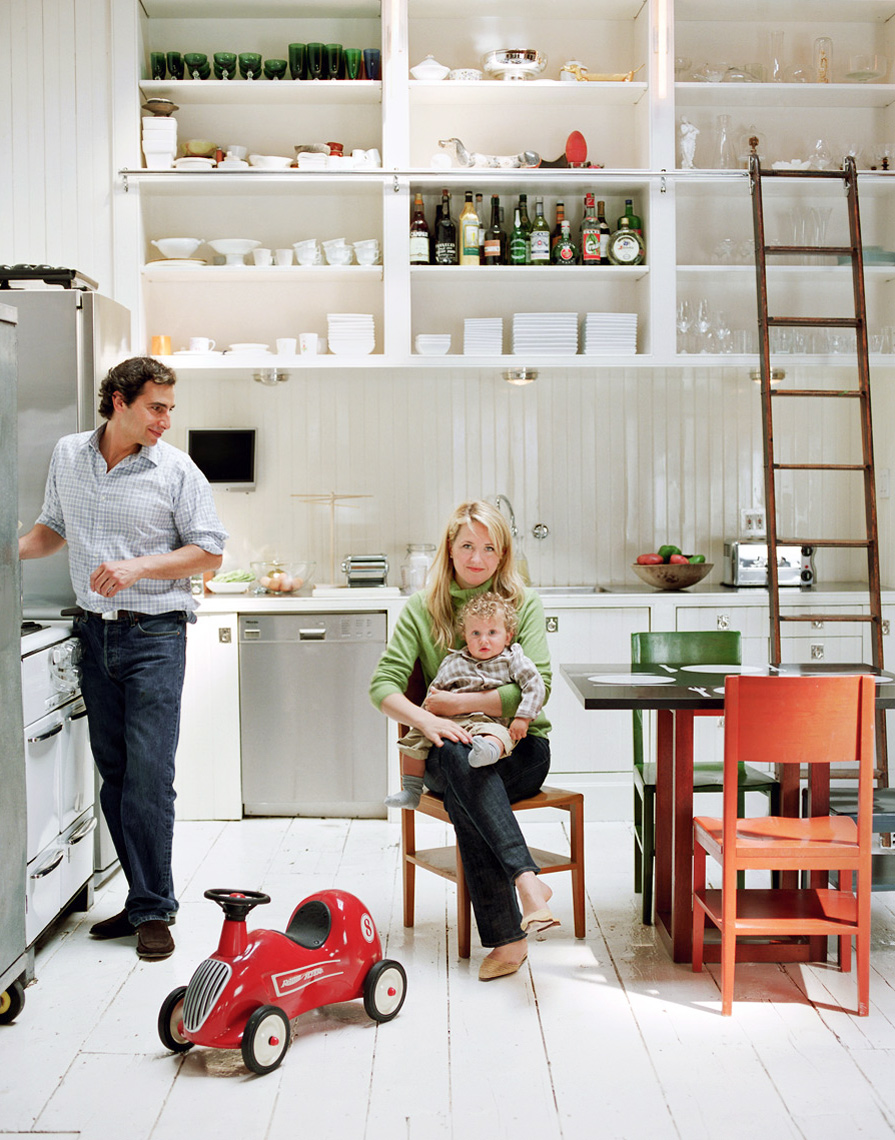 Couple in New York city loft apartment kitchen