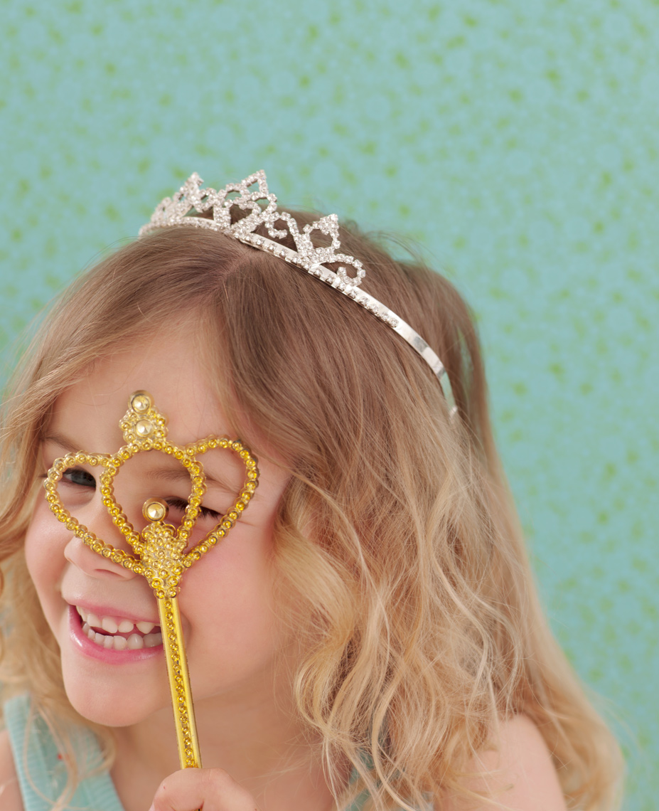 little girl with princess crown and princess wand with background