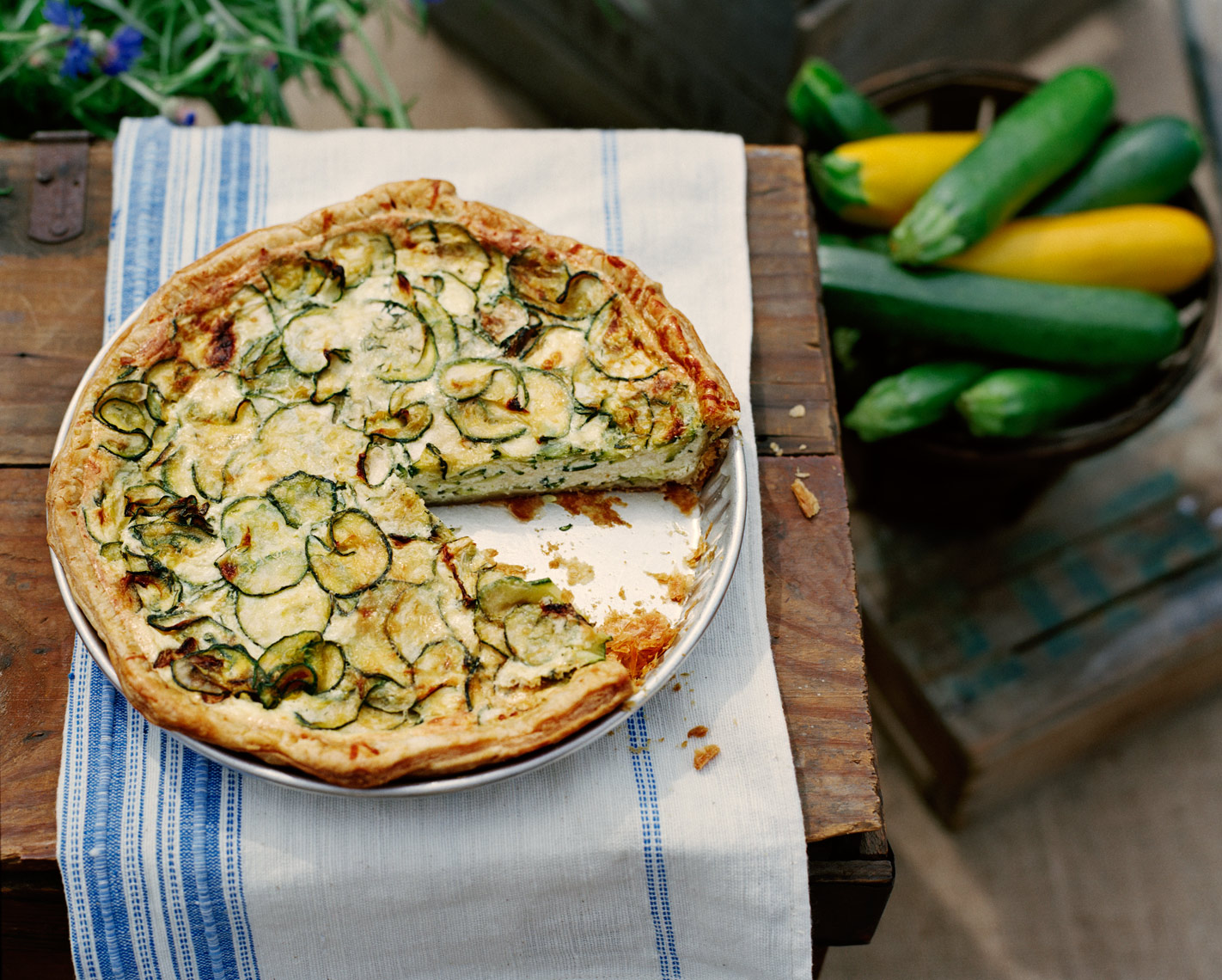 zucchini quiche with farmers market produce with vintage linen